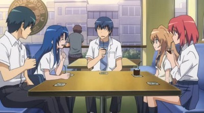 The main cast of five talk at a coffeeshop table