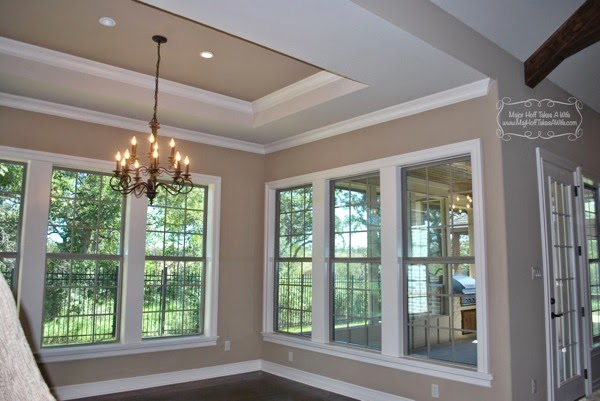 Dining room adjacent to sunroom with coffered ceiling
