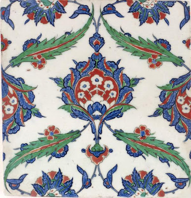 Tile | Origin:  Iznik,  Turkey | Period: ca. 1575  Ottoman period | Details:  The ambitious architectural projects sponsored by Suleyman the Magnificent (reigned 1522–60) and his ruling elite in the sixteenth century provided the necessary impetus for large-scale production of Iznik tiles. Using certain standardized sizes and shapes, Iznik tiles and three-dimensional objects share many of the same motifs and color combinations. The design for this tile is clearly part of a repeat pattern, which would have animated an interior or exterior surface, much like a curtain or a piece of textile. | Type: Stone-paste body painted under glaze | Size: H: 31.3  W: 30.0   D: 2.4  cm | Museum Code: F2001.15 | Photograph and description taken from Freer and the Sackler (Smithsonian) Museums.