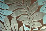 Tkanina obiciowa, trudnopalna. Pluszowa. Motyw roślinny - liście. Brązowa, szara, błękitna.