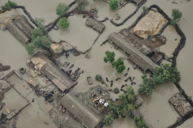 Aerial view of a flooded village in Pakistan, 2010. phillyworkersvoice.wordpress.com