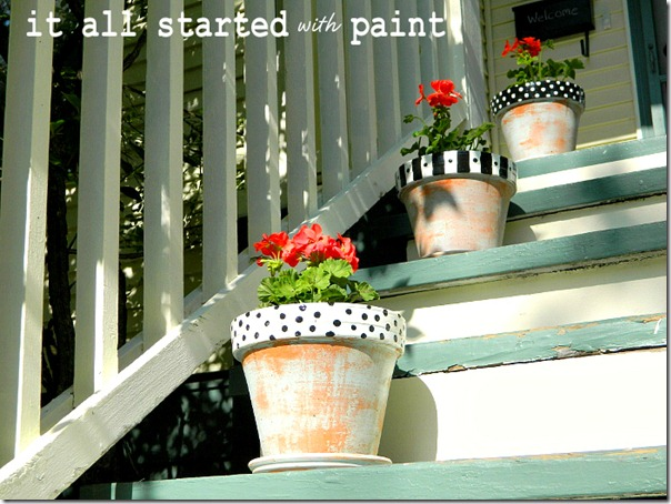 polka_dot_painted_terracotta_planters_perched_on_porch