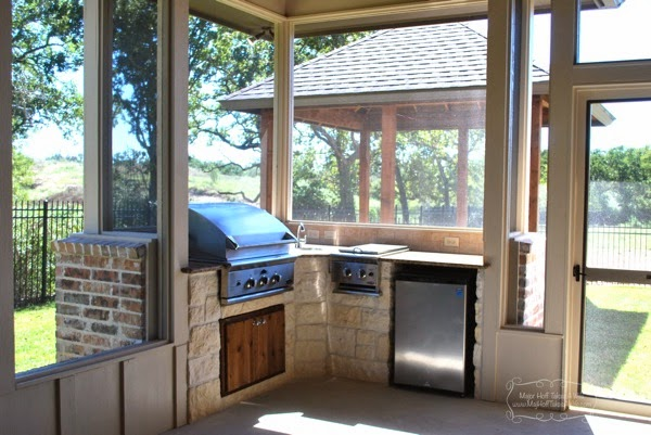 Outdoor screened in porch with bbq fridge and gazebo