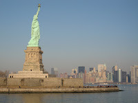 Statue of Liberty with NYC skyline.