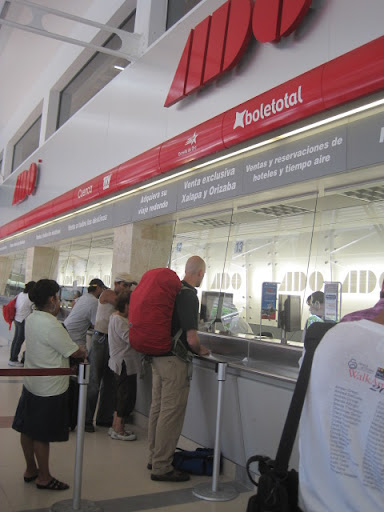 Erik getting us bus tickets, Veracruz, Mexico