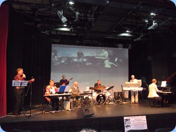 The North Shore Organ and Keyboard Club members playing for the first half the Concert at The PumpHouse Theatre 17th June 2012. Left to Right: Len Hancy; Barbara McNab; Brian Gunson; John Perkin; Ian Jackson; Peter Jackson; Denise Gunson.