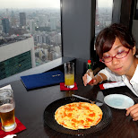 time for pizza on top of the Shiodome in Shinagawa, Tokyo, Japan