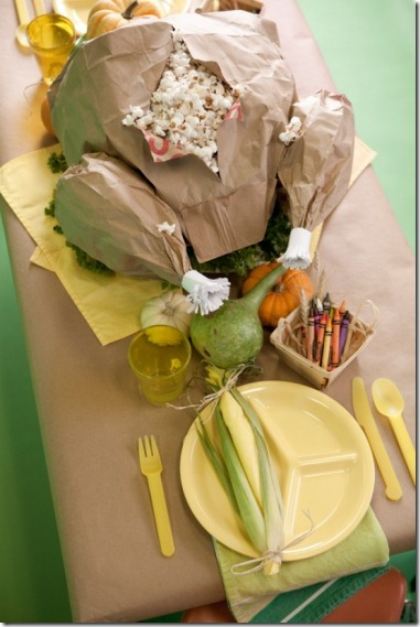 Thanksgiving kids table decorating and activity ideas--brown paper turkey stuffed with popcorn