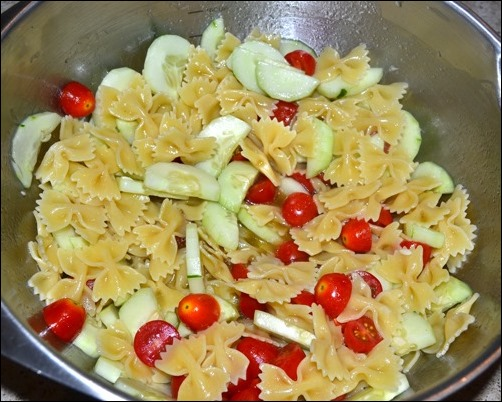 toss pasta and vegetables with sauce