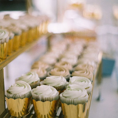 These golden cupcake holders make a classic treat look much more glamorous. (cocokelley.blogspot.com)