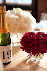 Puffs of my favorite flower, peonies, complemented champagne table numbers.