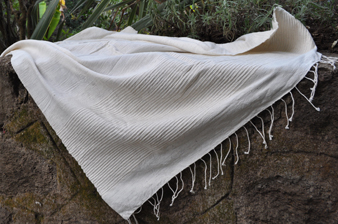 Natural throw with stripes feature.jpg