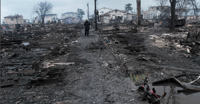 The day after 'super storm' Sandy, the coastal community of Breezy Point, in Far Rockaway, Queens remains devastated by fire and flooding. Andrew Lichtenstein / Corbis