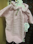 This pink fleece snuggly with its adjustable toggle closure at the neck is one of my favorites.  I've been cozy all winter.  I love the bone design.