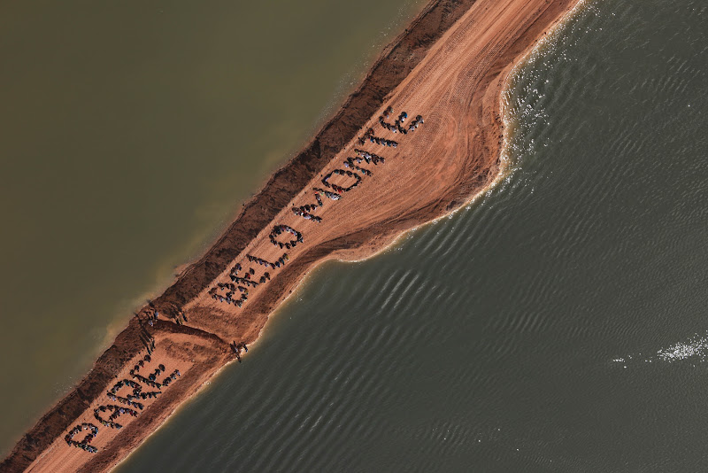 "Xingu River, Brazil - Three hundred indigenous people, small farmers, fisherfolk, and local residents occupied the Belo Monte Dam project, removing a strip of earth to restore the Xingu's natural flow and ""freeing the river.""   Participants gathered in formation spelling out the words ""Pare Belo Monte"" meaning ""Stop Belo Monte"" to send a powerful message about the devastating impacts of the dam on the eve of the UN Rio+20 Summit.  Their message is that projects that destroys livelihoods and the environment and that violate indigenous rights cannot be called ""Clean Energy"". They are demanding the cancellation of the $18 billion Belo Monte dam project. (Photo credit: Atossa Soltani/ Amazon Watch / Spectral Q)"