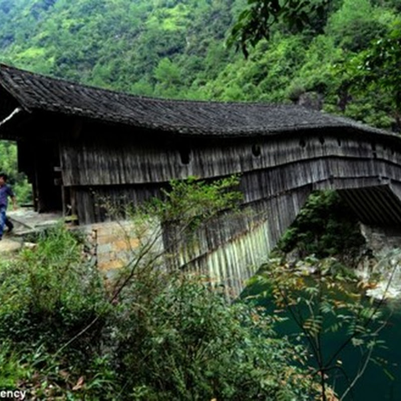 THE STUNNING 1,000-YEAR-OLD WOODEN BRIDGES THAT KEEP MODERN CHINA MOVING