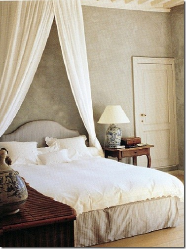 Axel Vervoordt Timeless Interiors gray bedroom with white linens