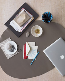 Personalize Mom's desk with a free-form stone-shaped blotter; it's a great way to protect the surface or to designate a writing area. Plus it takes just minutes to make: Outline the shape you want on the back of the leather, and cut it out with heavy-duty scissors (marthastewart.com)