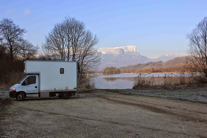 Alex van next to lake and mountains