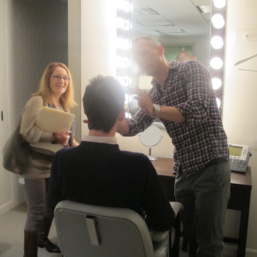 My hair stylist Anthony Sorensen coifs my 'do, while Producer Barbara Fight makes sure he doesn't miss any stray hairs. Getting ready for TV can be so laborious!