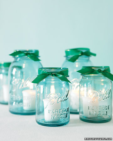 Ball glasses (especially antique ones) are often tinged with turquoise. An emerald ribbon brings my color combo to these centerpiece votives. (http://www.marthastewartweddings.com/)