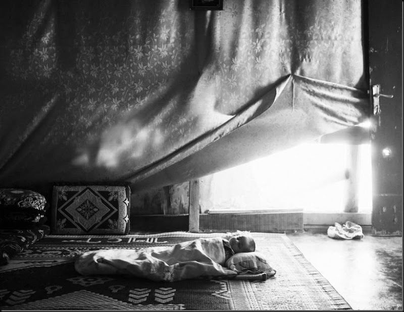 A Syrian baby sleeps inside his family's tent in the Bekaa Valley, Lebanon. (Moises Saman/Magnum Photos for Save the Children)
