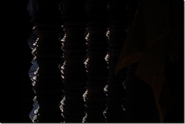 Light coming through the pillars inside Angkor Wat