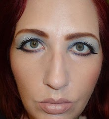 wearing 3D Eyeshadow in irresistible  midnight date from essence cosmetics