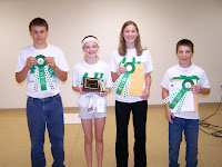Macy Marek of the Jackson Jets displays her Judge's Choice Intermediate Presentation trophy.  David Fladung of Limecreek Livewires, Madeline Hora of the Jackson Jets and Michael Witt of the Jackson Jets will represent Washington County at the State Fair.  Hannah Van Roekel of the Limecreek Limelights 4-H Club was selected as State Fair alternate.  Photo Courtesy of the Washington County Extension.