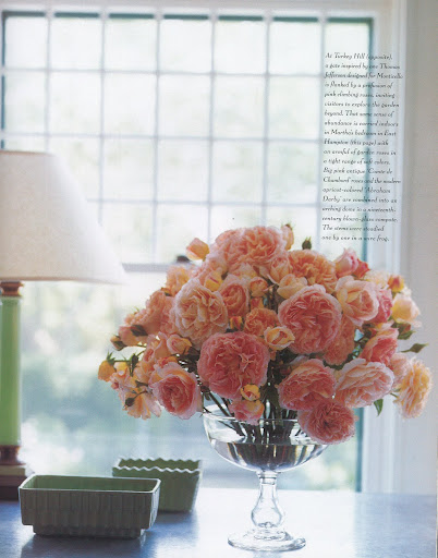 Big pink antique 'Comte de Chambord' roses and the modern apricto-colored 'Abraham Darby' are combined into an arching dome in a nineteenth-century blown-glass compote. (The Best of Martha Stewart Living -- Arranging Flowers)