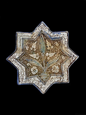 Eight-pointed Star Tile | Origin:  Iran | Period: early 14th century  Il-Khanid period | Details:  Not Available | Type: Stone-paste painted colorless glaze | Size: H: 21.0  W: 21.3  cm | Museum Code: F1973.16 | Photograph and description taken from Freer and the Sackler (Smithsonian) Museums.