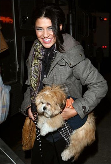 Jessica Szohr, who played Vanessa Abrams on the TV show Gossip Girl carries her small fluffy dog Watson around Brooklyn