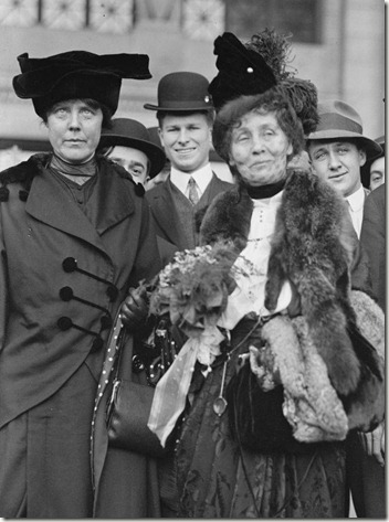 On the far left, American suffragist Lucy Burns (1879 - 1966) of the Congressional Union For Women Suffrage (CUWS) stands next to Mrs Emmeline Pankhurst (center) probably in Washington, DC, 1913. (Photo by PhotoQuest/Getty Images)