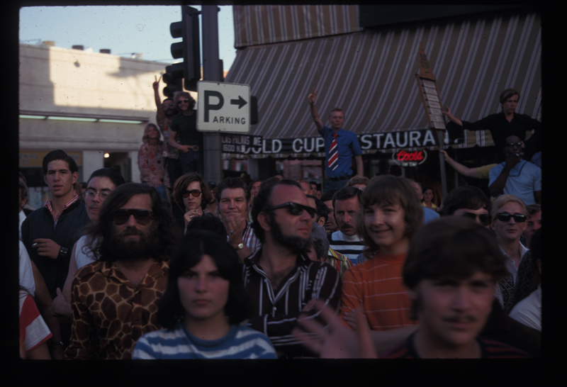 The crowd at Los Angeles's first Christopher Street West pride parade in front of the Gold Cup Restaurant. 1970.