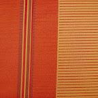 Elegancka tkanina w pasy. Czerwona, pomarańczowa. Na zasłony, poduszki, dekoracje. Duża szerość.