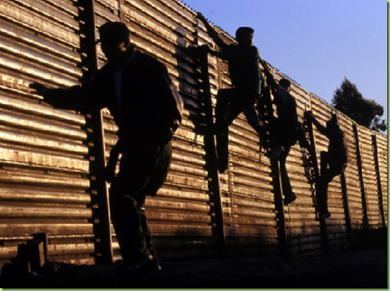 immigrants-fence-climbing