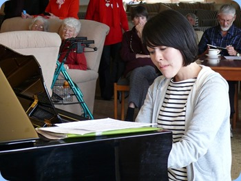 Kuniko Nakatani playing the Kohler and Campbell grand piano with great sensitivity of touch. Photo courtesy of Dennis Lyons.