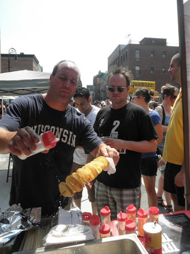 Here's Wade seasoning a piping-hot chip on a stick for an eager customer.