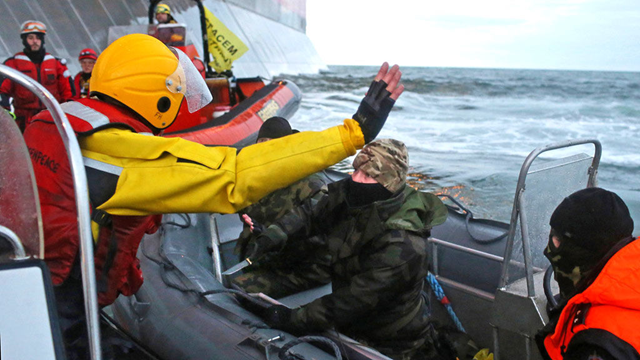 Activist Frank Hewetson is held at knifepoint by Russian security forces. The crew of the Greenpeace ship 'Arctic Sunrise' were placed under armed guard at 7pm on 19 September 2013. Photo: Greenpeace