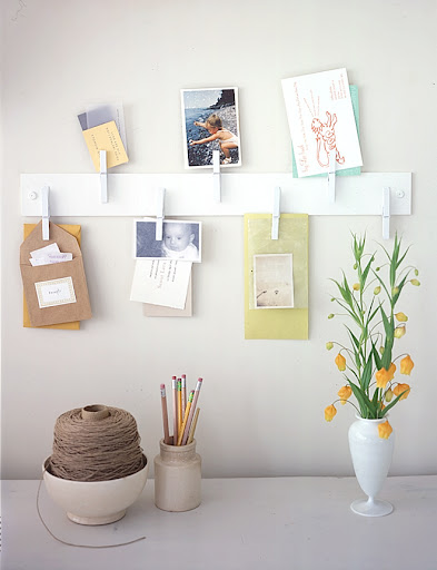 This clothespin organizer is easy to make–just attach pins to a piece of wood and mount to the wall. Pin up small items like postcards, invitations, and business cards that might get lost otherwise.