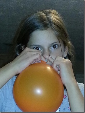 Rebkekah blowing balloon with nose