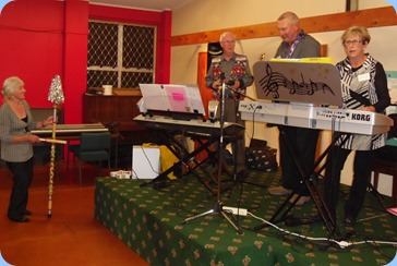 Peter Brophy, Kevin and Jan Johnston doing their gig at the Raglan Club Saturday Night Concert. Delyse Whorwood couldn't contain her enthusiasm and took over the percussion section (seen on the left!).