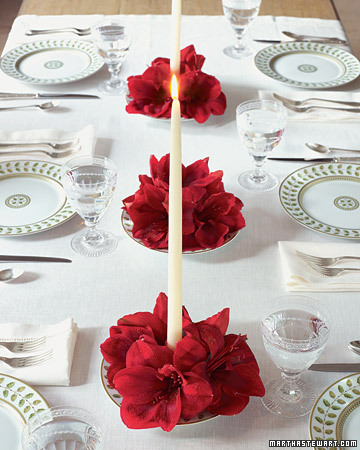 Light up your centerpieces by resting amaryllis blooms in bowls around your candles.