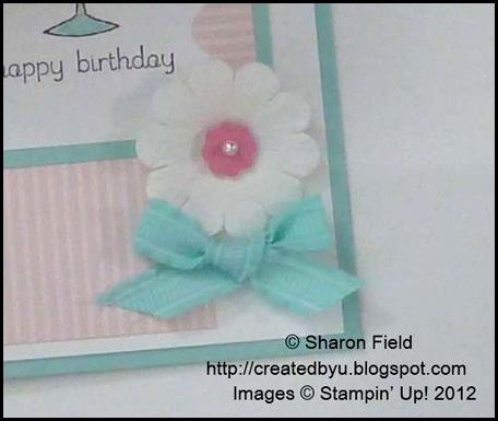 itty bitty punch pack and paper daisy accented with bow and pearl