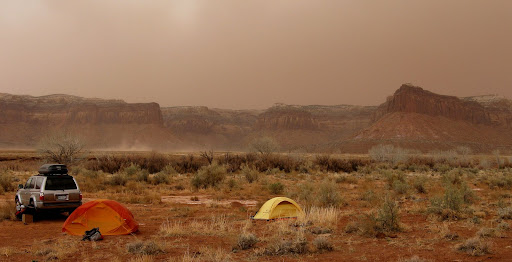 We setup camp in a dust storm Sun evening. Thankfully, only light rain fell overnite.