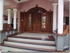 Kerala veedu hand carved interior wood work at cherthala for Veedu interior photos