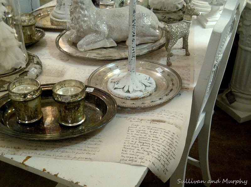 table topped with silver and glass