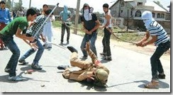 stone pelters in kashmir beating army