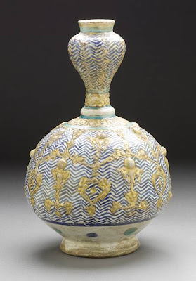 Bottle Iran Bottle, 13th century Ceramic; Vessel, Fritware, overglaze painted, 8 5/8 x 3 in. (21.9075 x 7.62 cm) Gift of Mr. and Mrs. Allan C. Balch (M.45.3.118) Art of the Middle East: Islamic Department.