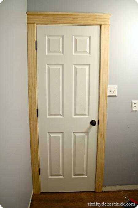 Diy craftsman door trim from thrifty decor chick for Craftsman style door casing